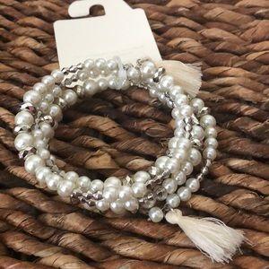 Pretty faux pearl spiral bracelet with tassels